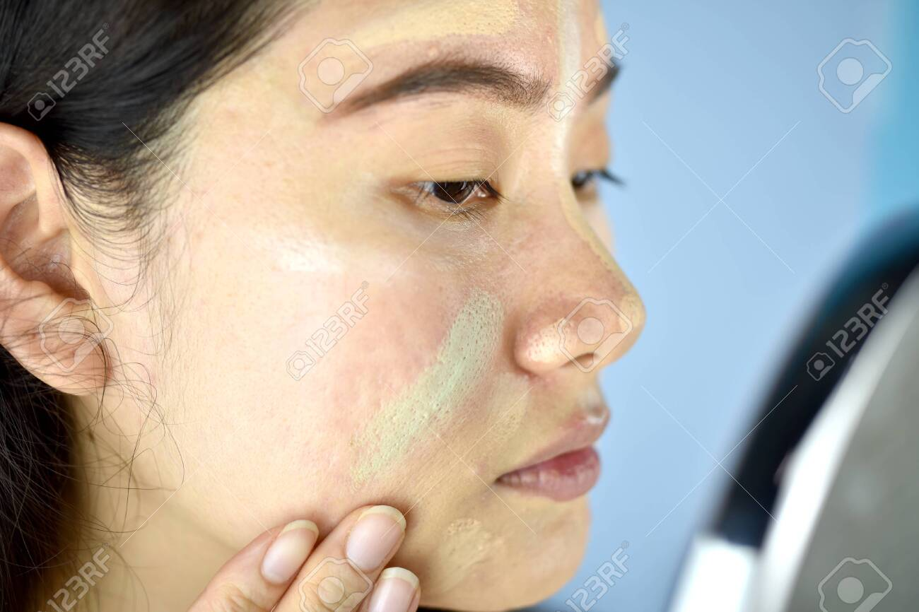 Asian Woman Applying Cosmetics Makeup And Using Color Correction Stock Photo Picture And Royalty Free Image Image 125381589