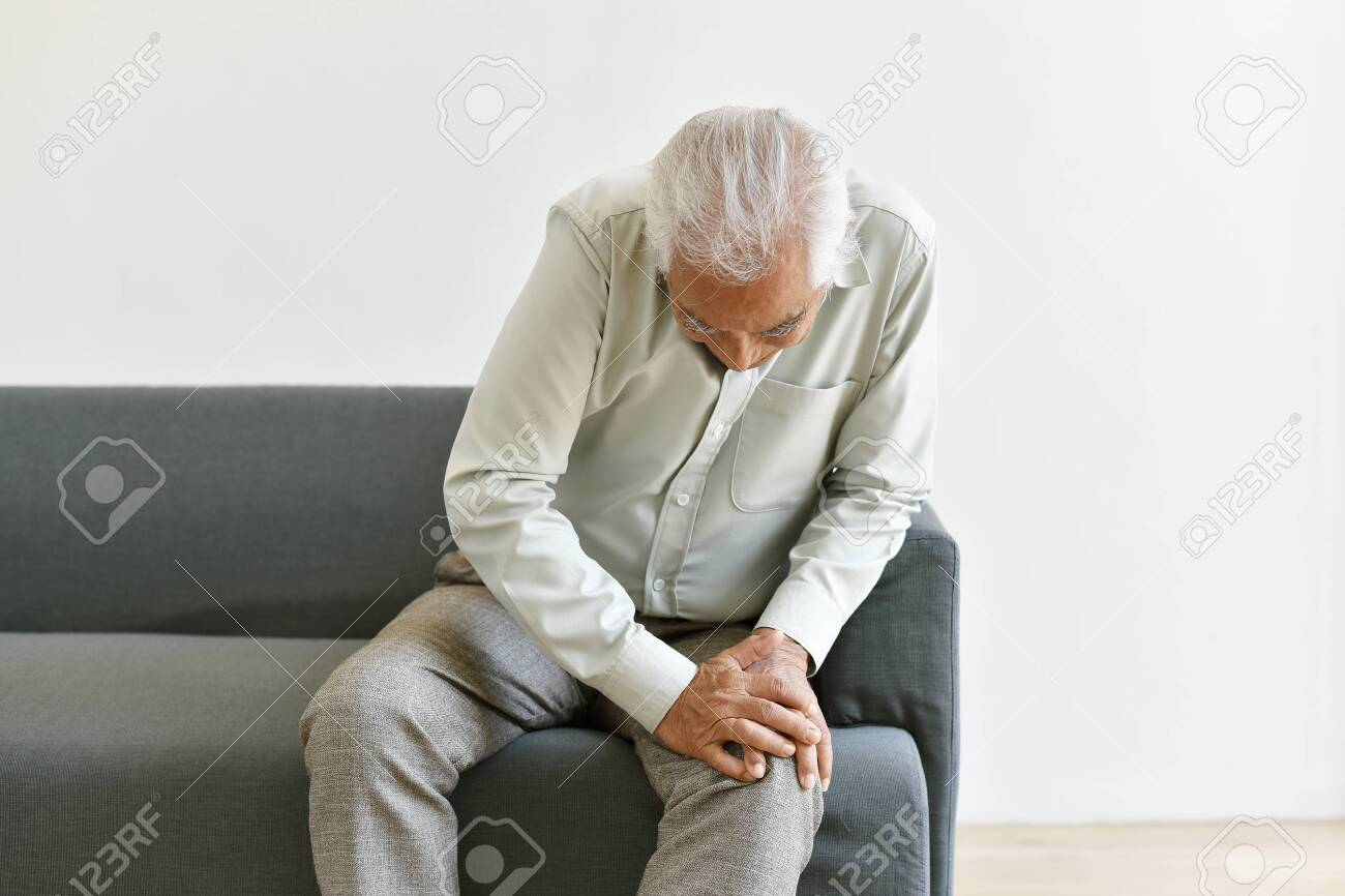 Arthritis joint pain problem in old man, Elderly asian man with hand on knee gesture, Senior suffering and worry about injury symptom, Healthcare insurance concept. - 129000528