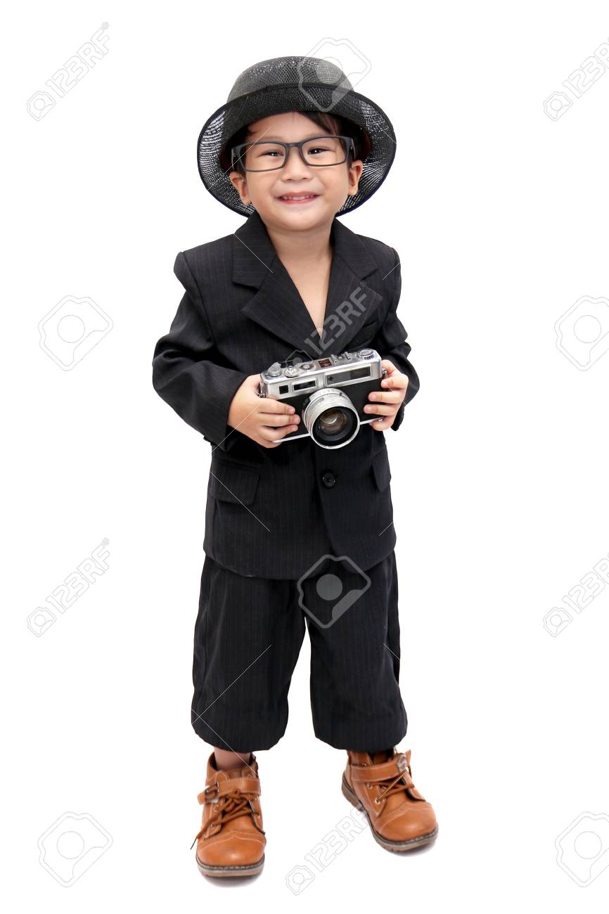 asian cute boy with camera vintage Stock Photo - 72854303