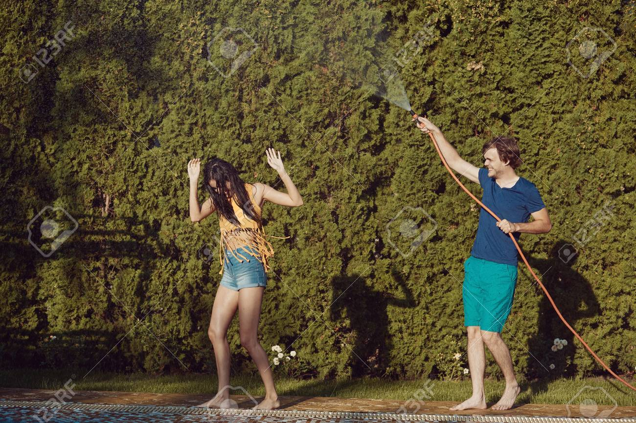 Healthy Lifestyle: Couple Having Fun Pour Each Other With Garden ...
