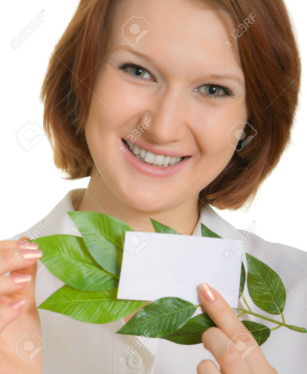 smiling girl with a business card and leaves of plants. Focusing on the eyes Stock Photo - 4567368