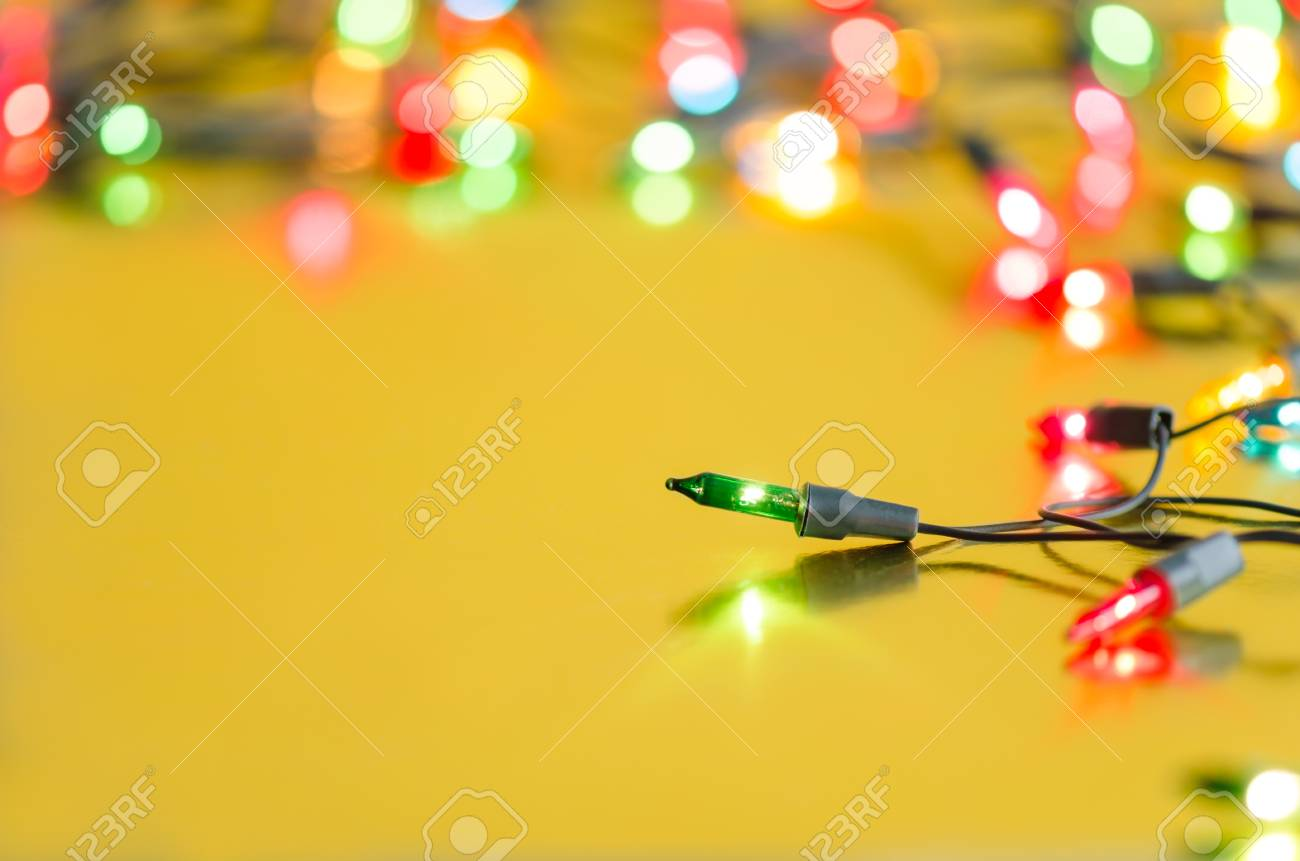 wholesale dealer c8eab b9d34 Xmas light bulbs on string in multi colours  blue, yellow, green, pink    red on gold yellow background with copy space   bokeh (blurry lights) for  Christmas ...