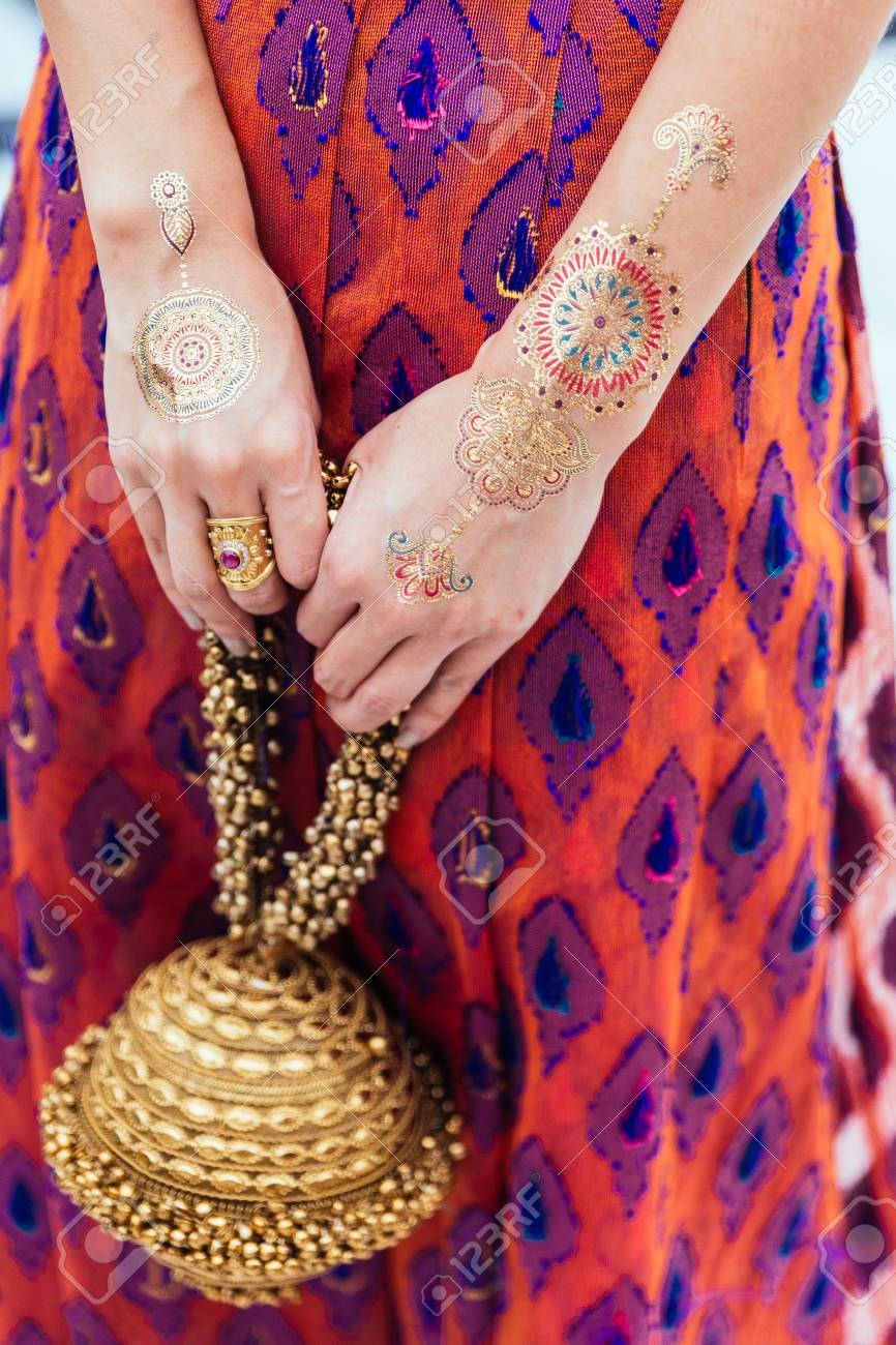 Henna Tattoo On Both Hands And Arms For Woman At Indian Wedding