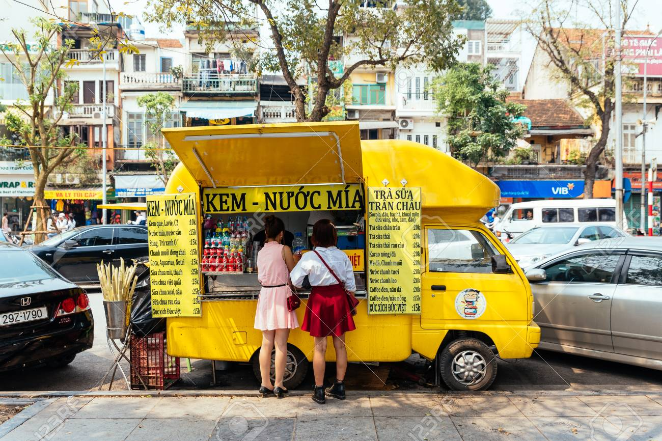 Vietnamese Yellow Food Truck With Customers On The Street In Stock Photo Picture And Royalty Free Image Image 95617716
