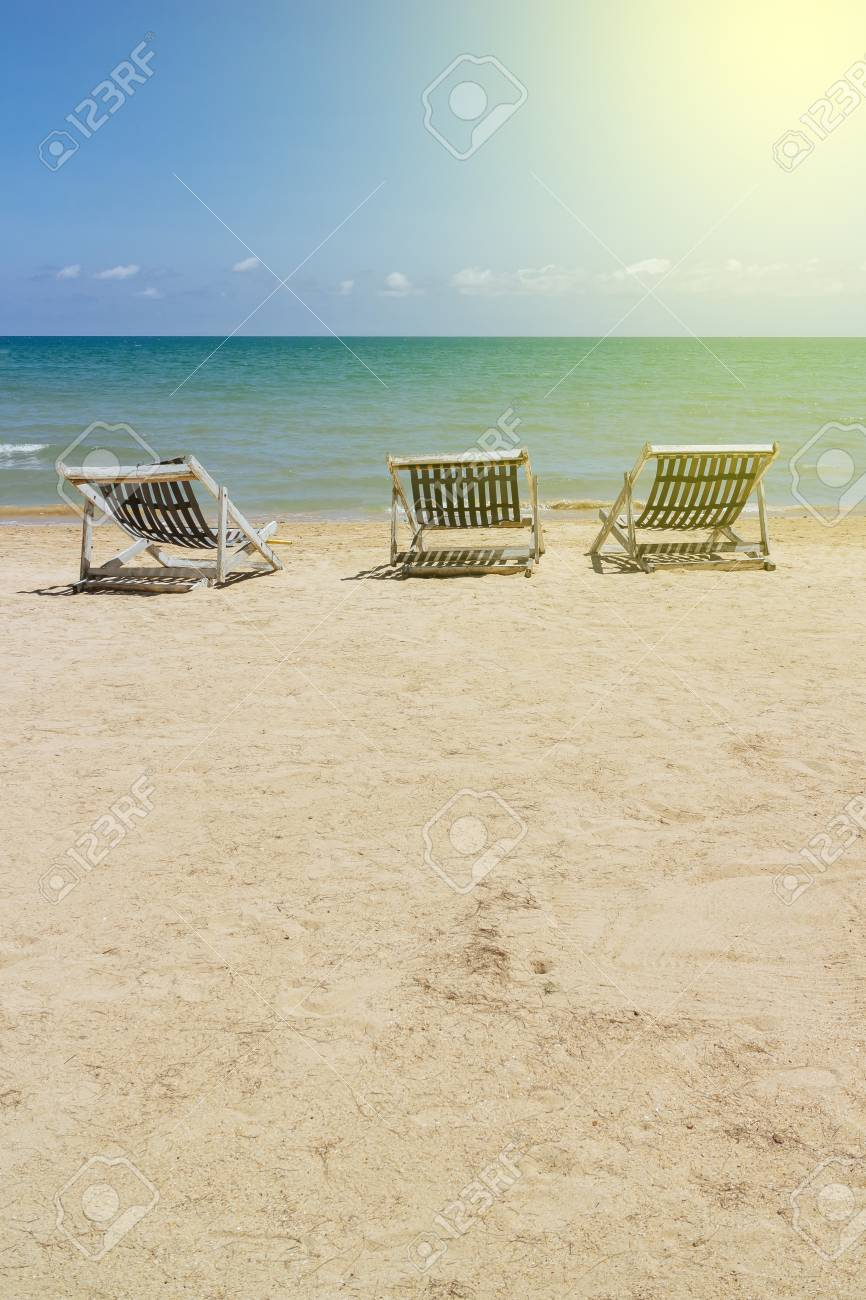 Marvelous Three Folding Beach Chairs On The Beach With Sea Bright Sky Beatyapartments Chair Design Images Beatyapartmentscom