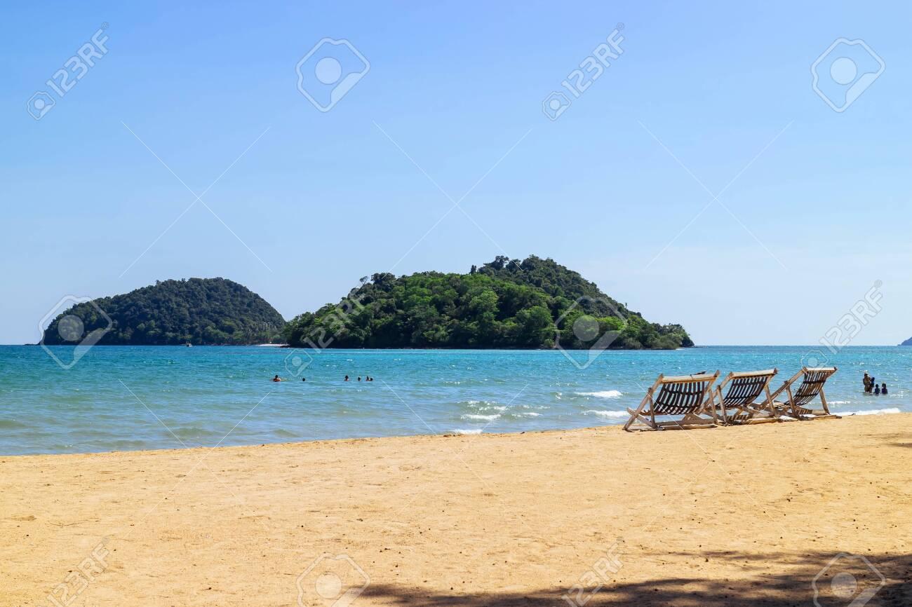 Phenomenal Three Folding Beach Chairs On The Beach With Sea Bright Sky Beatyapartments Chair Design Images Beatyapartmentscom