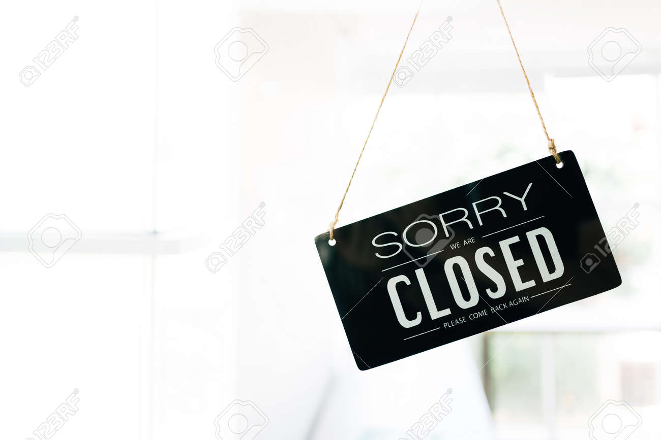 Sorry And Closed Sign Board Through The Glass Of Door In The Stock Photo Picture And Royalty Free Image Image 156869621