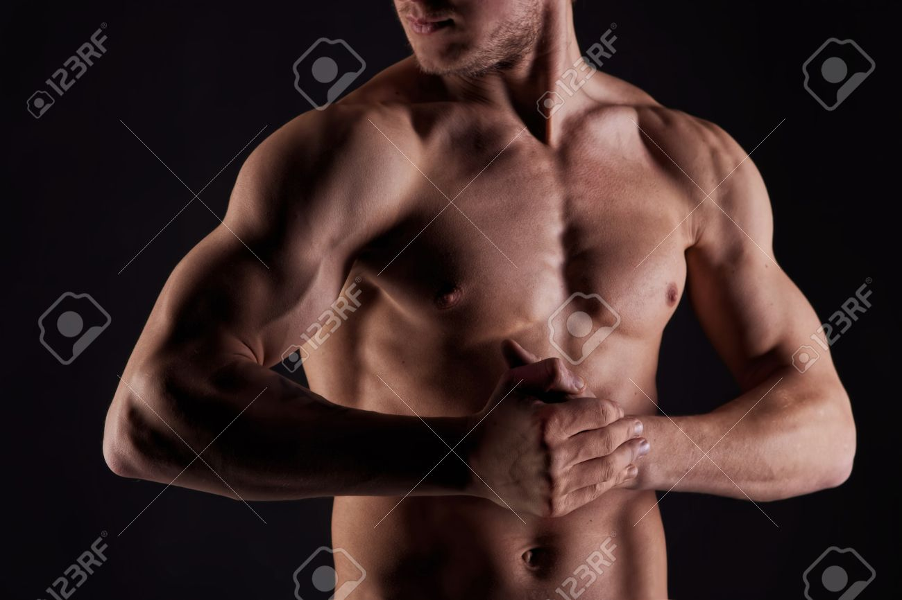 Sexy muscular naked man with water drops on stomach Stock Photo - 8851397