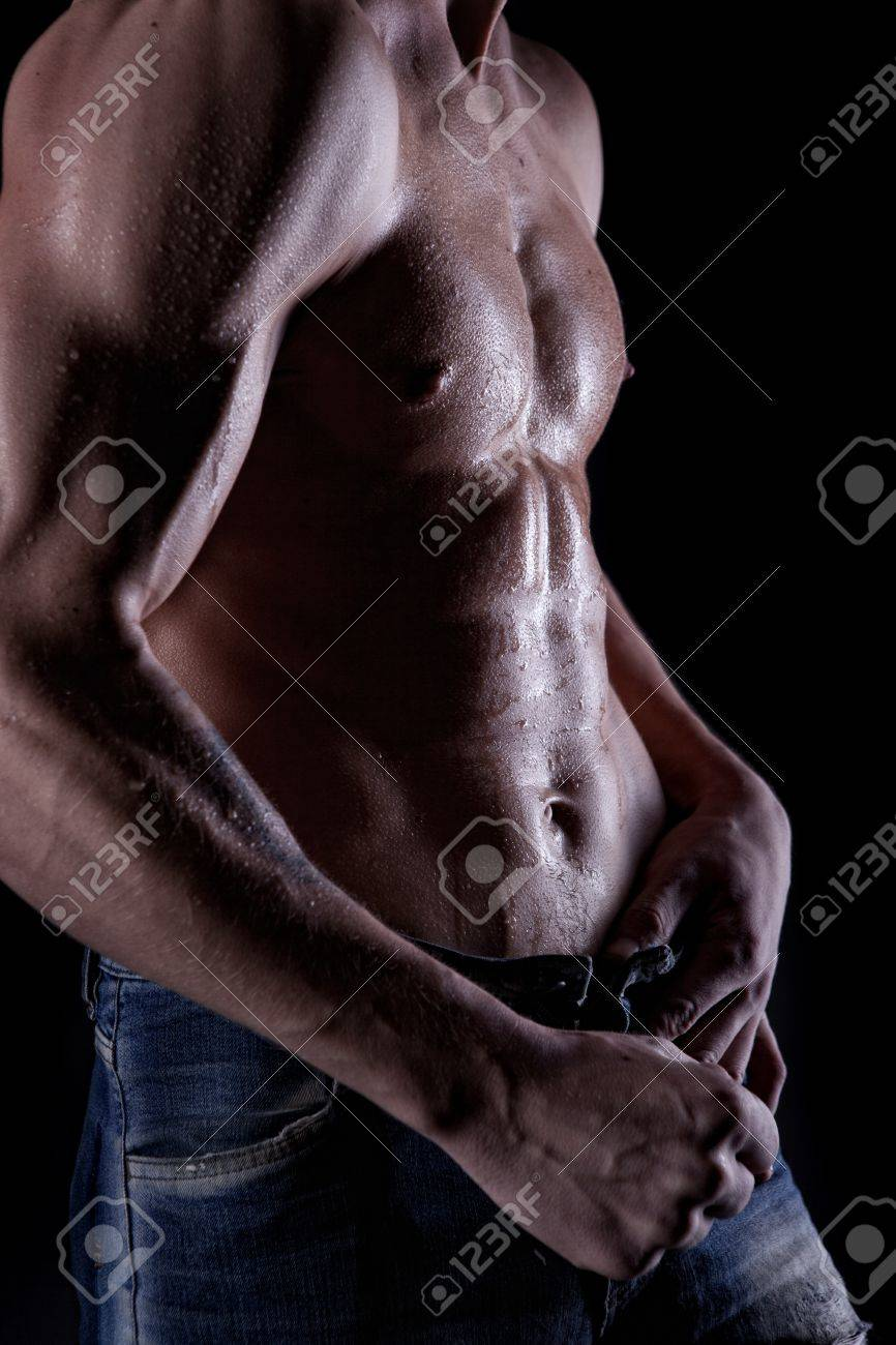 Posing muscular man with body in water drops on black Stock Photo - 8990064