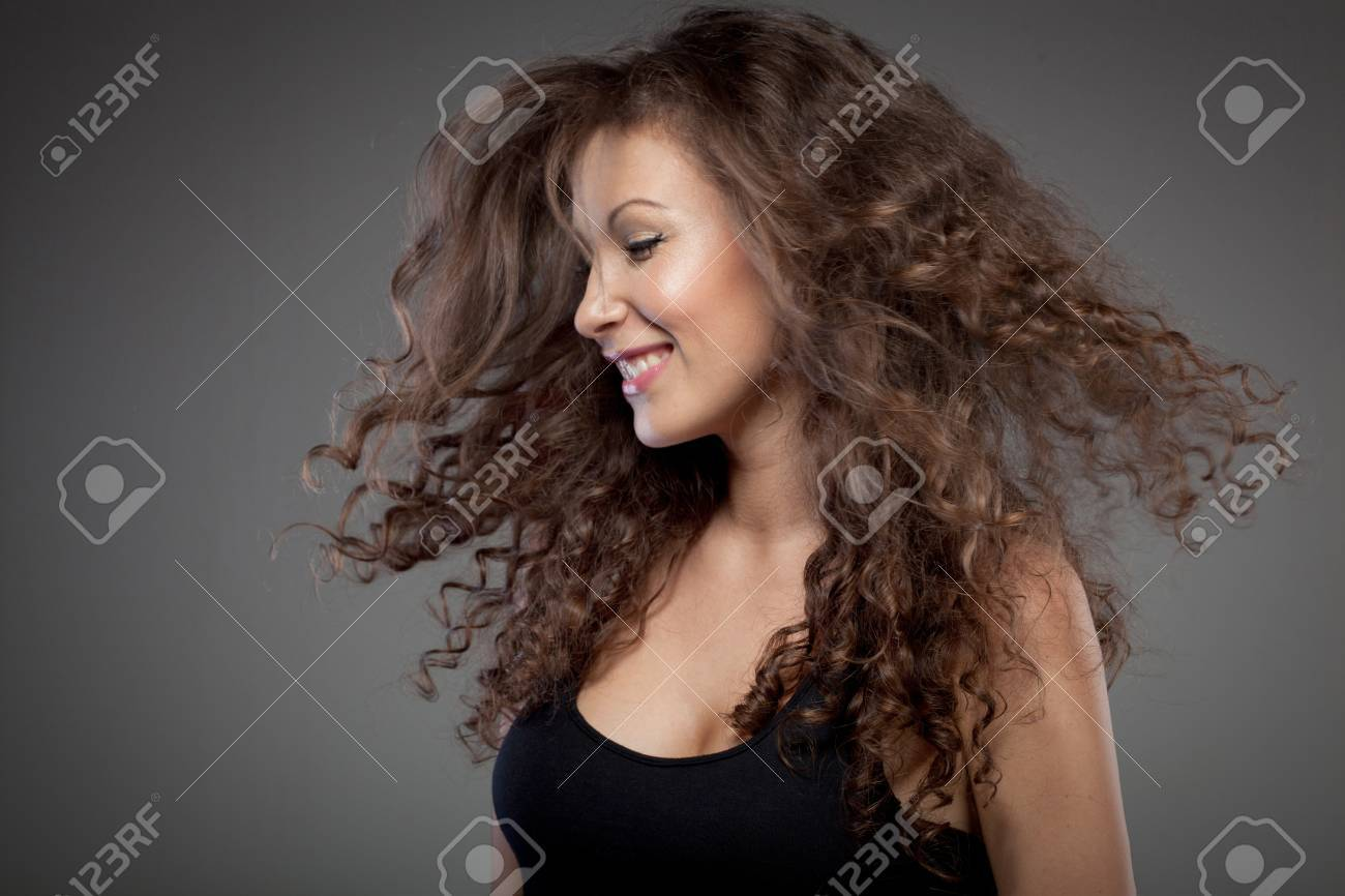 portrait of smiling woman with curly hair Stock Photo - 9952847