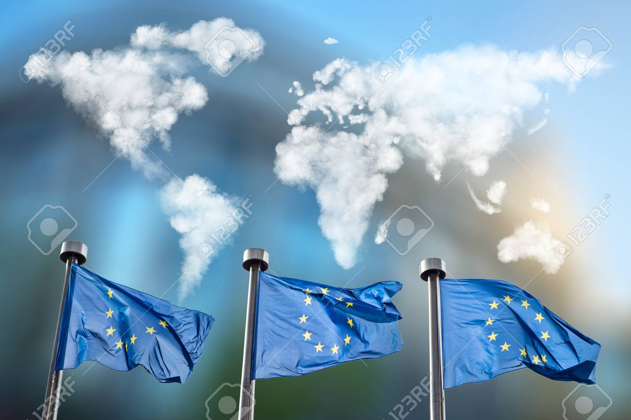 Flags of european union with world map made of clouds against flags of european union with world map made of clouds against european parliament in brussels gumiabroncs Gallery