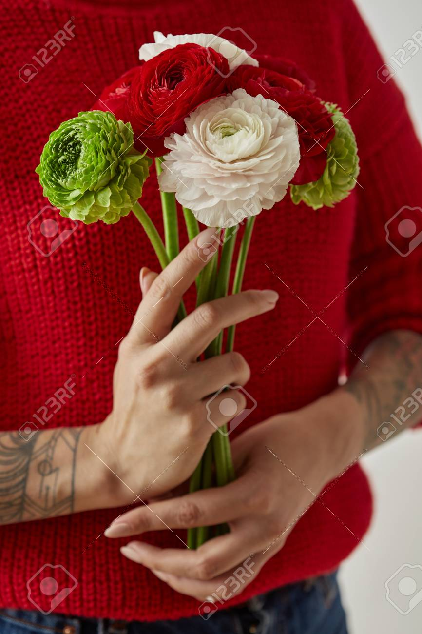 Girl With A Tattoo On Her Hands Holding A Bouquet Of Flowers Stock