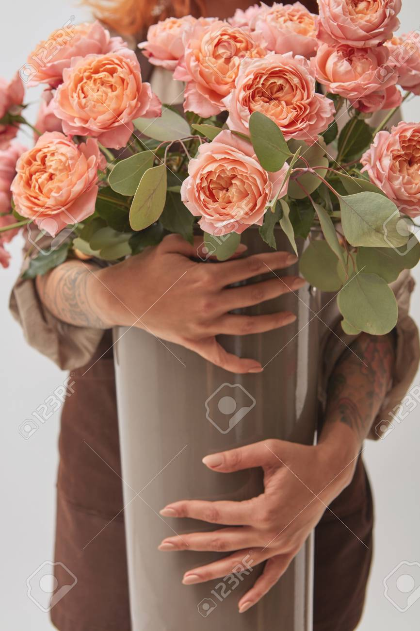 A Girl Holding A Vase In Her Hands Vase With A Bouquet Of Pink