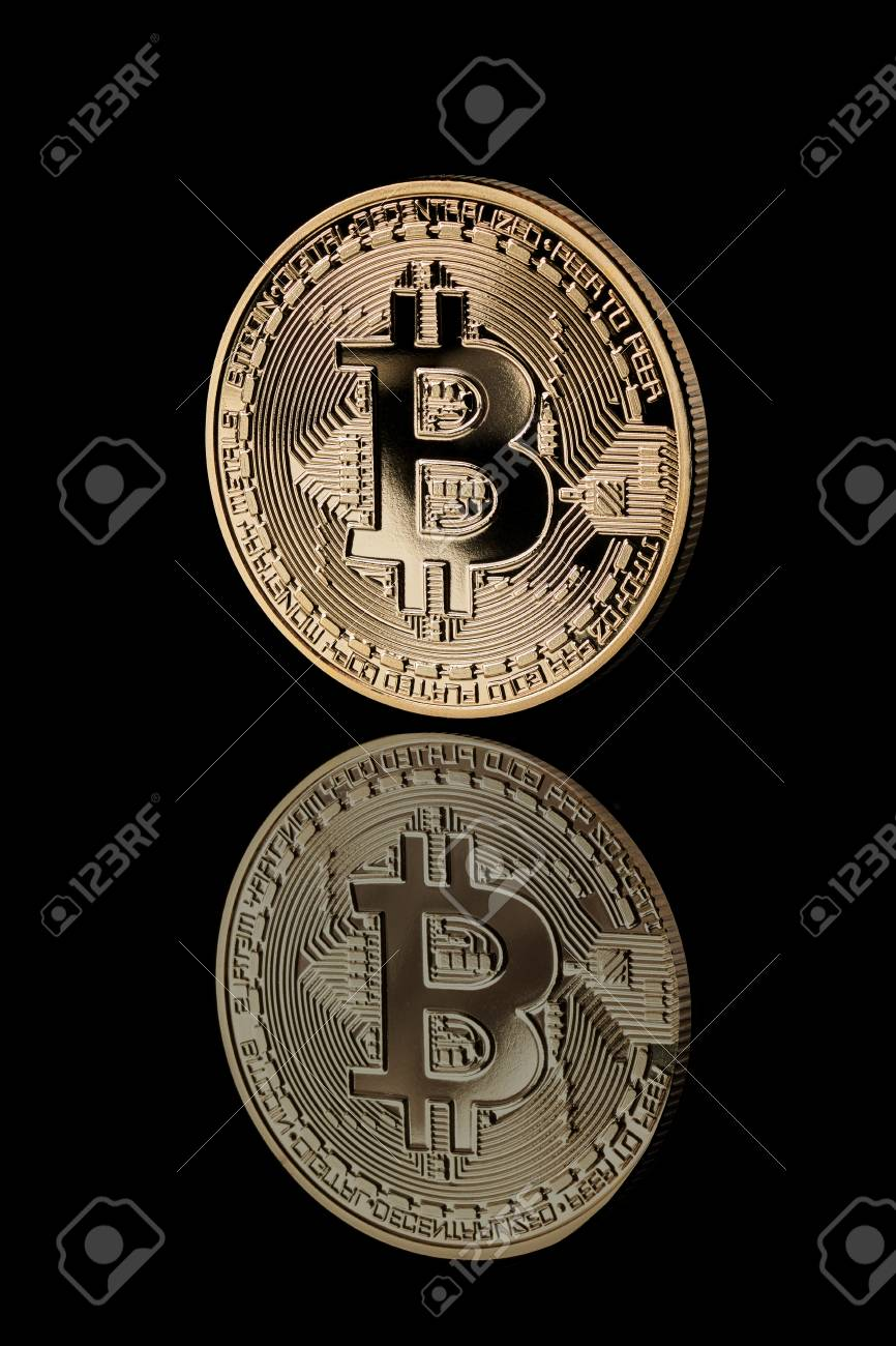 Gold Bitcoin Coin  Reflection of bitcoin icons on a black background
