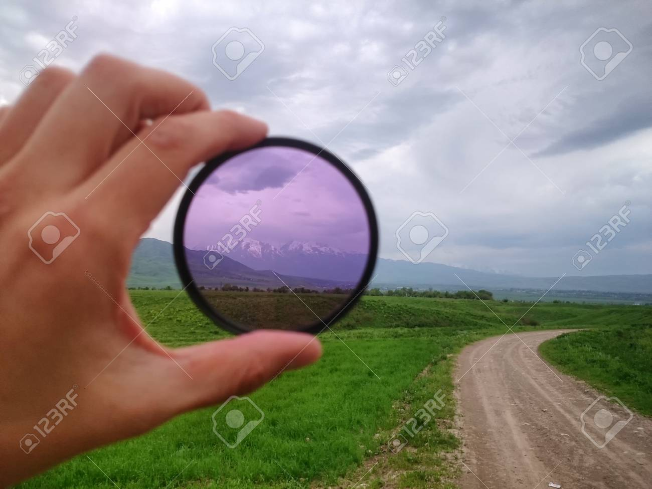 Landscape through a filter in hand - 59116075