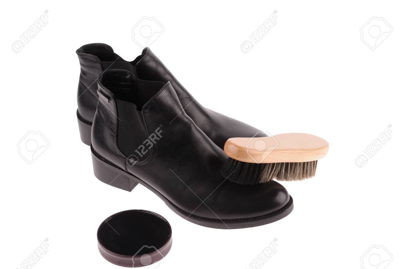 bcdfc283ec1 black boots with shoe brush isolated over white background Stock Photo -  27733030