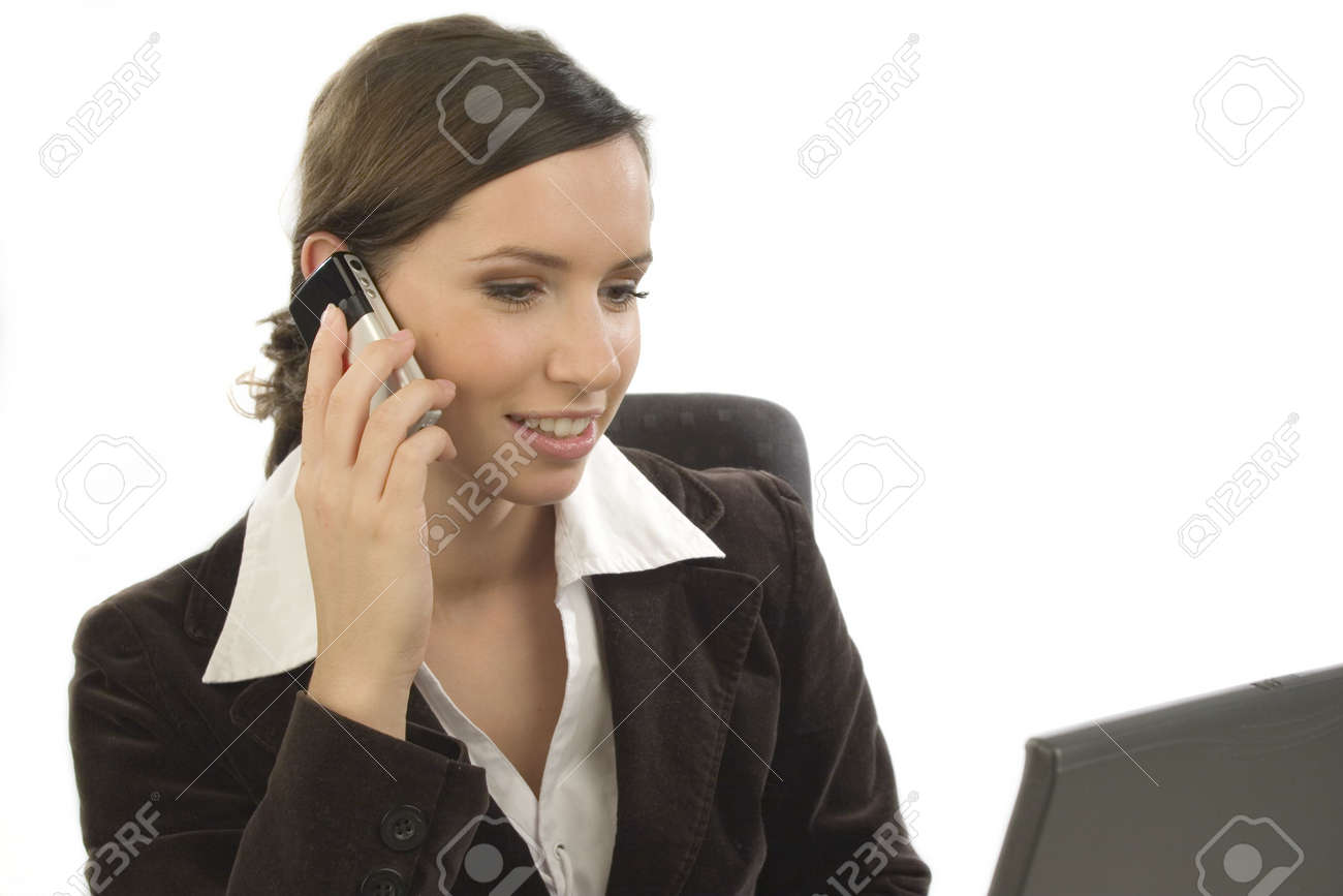 Young woman with cell phone looking at a laptop Stock Photo - 781472