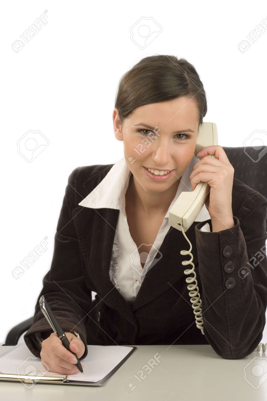 Young smiling businesswoman with telephone taking notes Stock Photo - 2633575