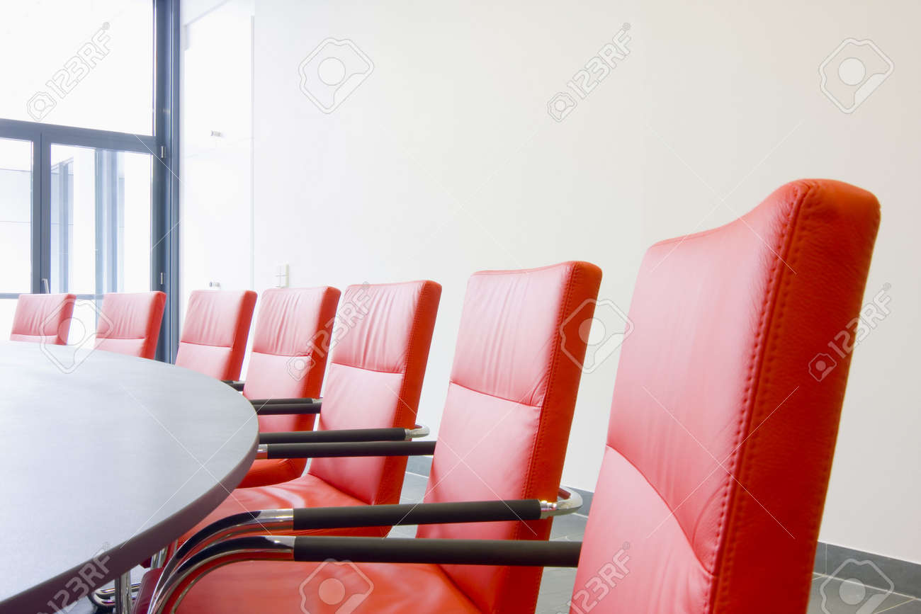 Red conference room chairs - Red Leather Chairs In A Conference Room Stock Photo 3365389