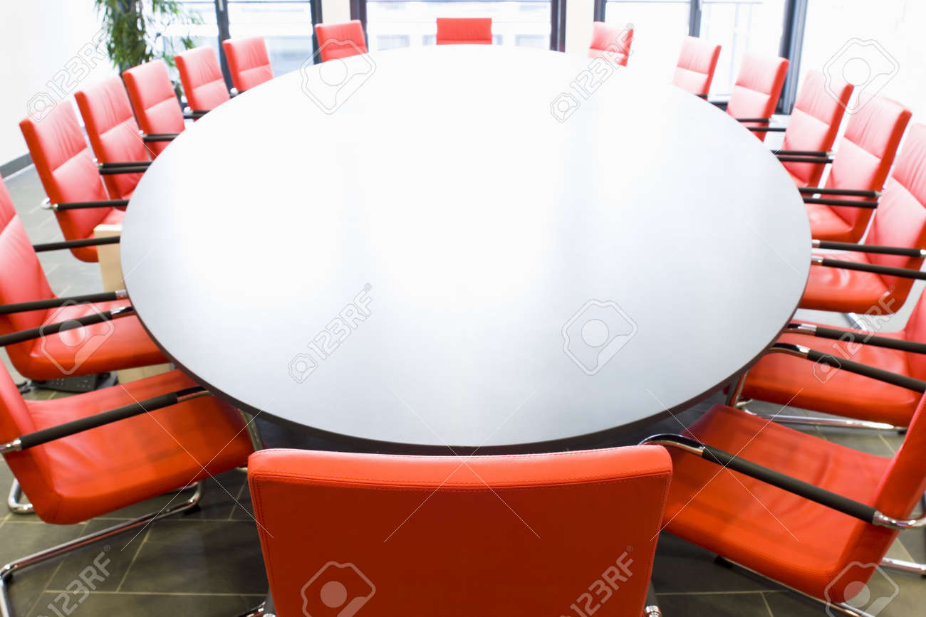 Meeting Room With Red Chairs And Oval Conference Table Focus - Oval conference room table