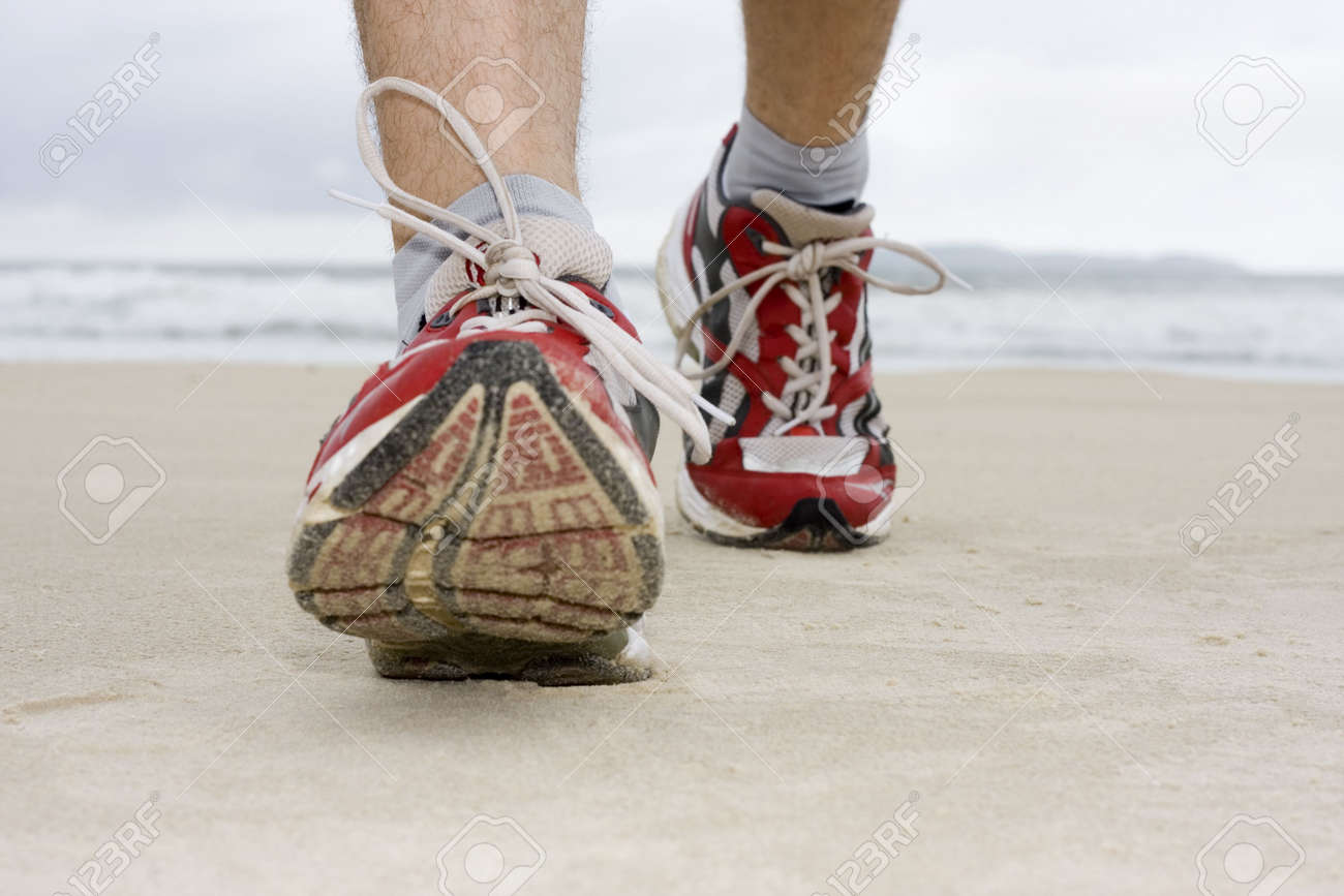 Feet of man with sneakers jogging on a beach Stock Photo - 6956929