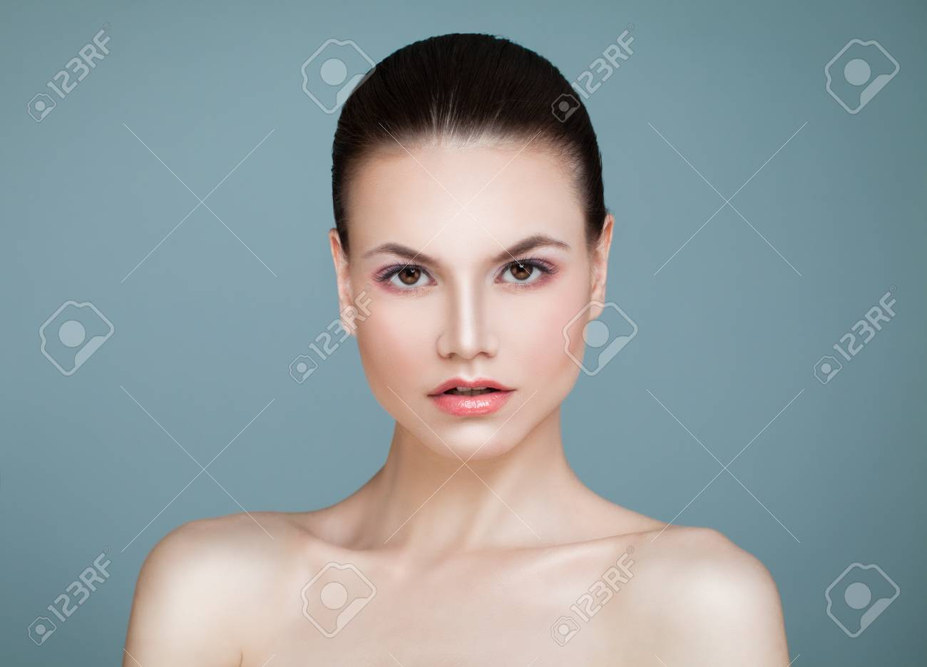 Spa Beauty  Young Woman with Healthy Skin on Blue Background
