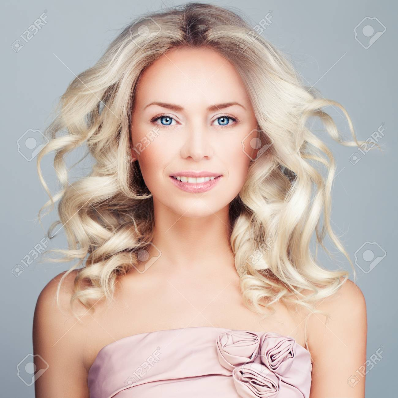 Perfect Blonde Woman With Blowing Curly Hair And Prom Dress Fashion Model Wavy