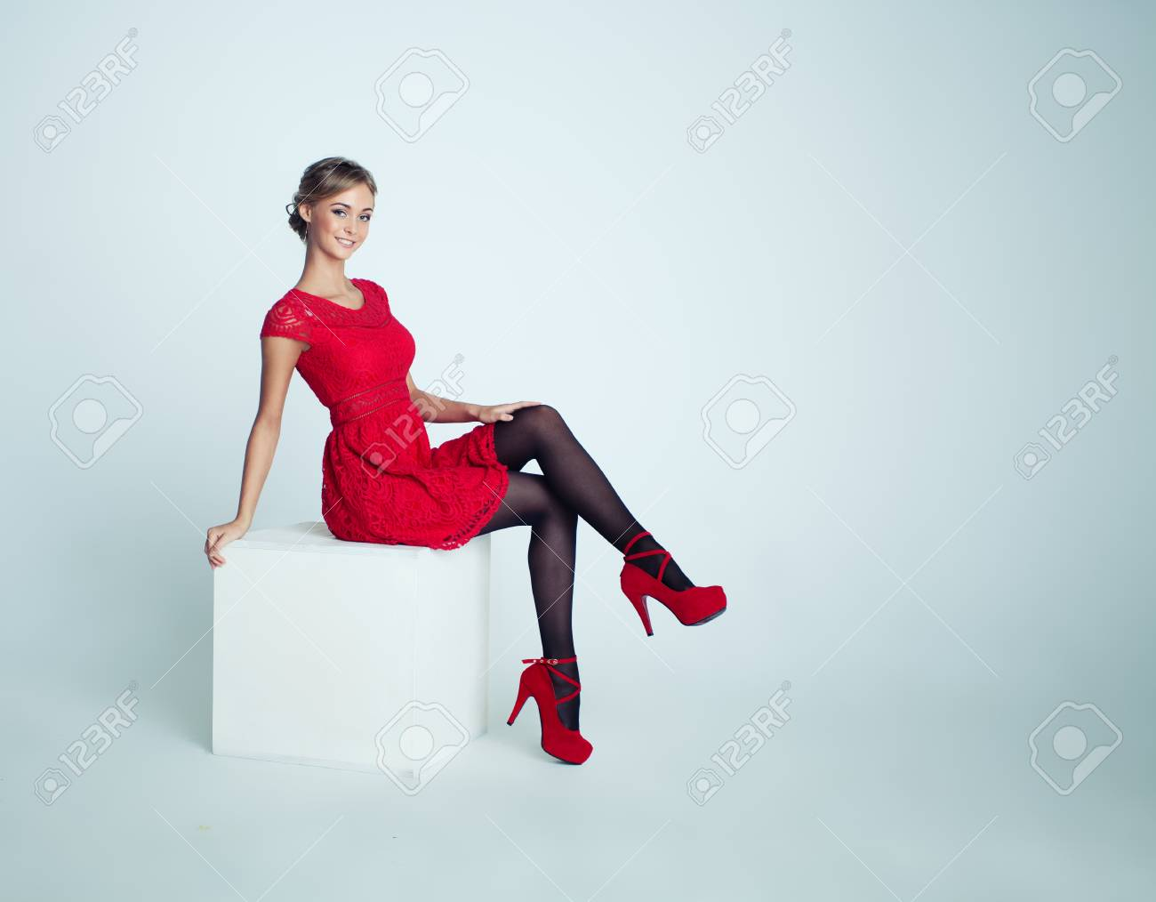Happy Woman in Red Dress on White Background - 103152810