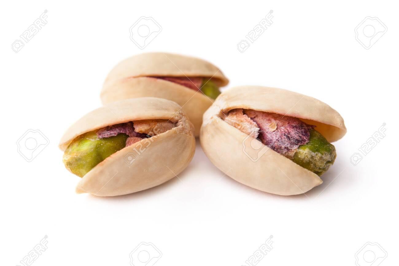 Tasty pistachio nut isolated on white background - 131847635
