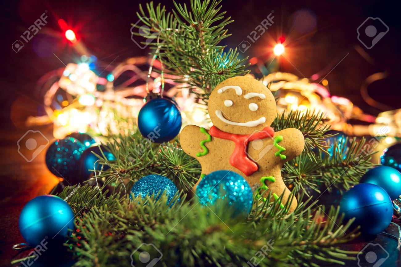 gingerbread man near christmas tree with toys by garland the concept of christmas stock photo - Christmas Tree With Garland
