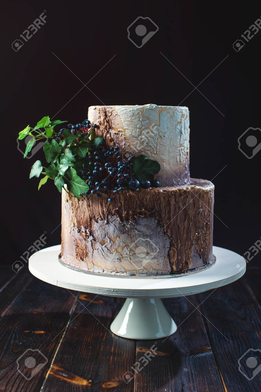 Two Tiered Wedding Cake In The Form Of Stump Wood And Bark With