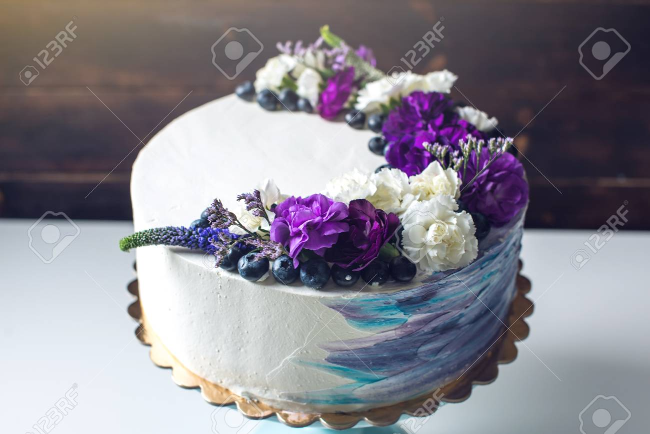 Colorful Wedding Cream Cake With Lovely Purple Flowers Adorn Stock Photo Picture And Royalty Free Image Image 74916219