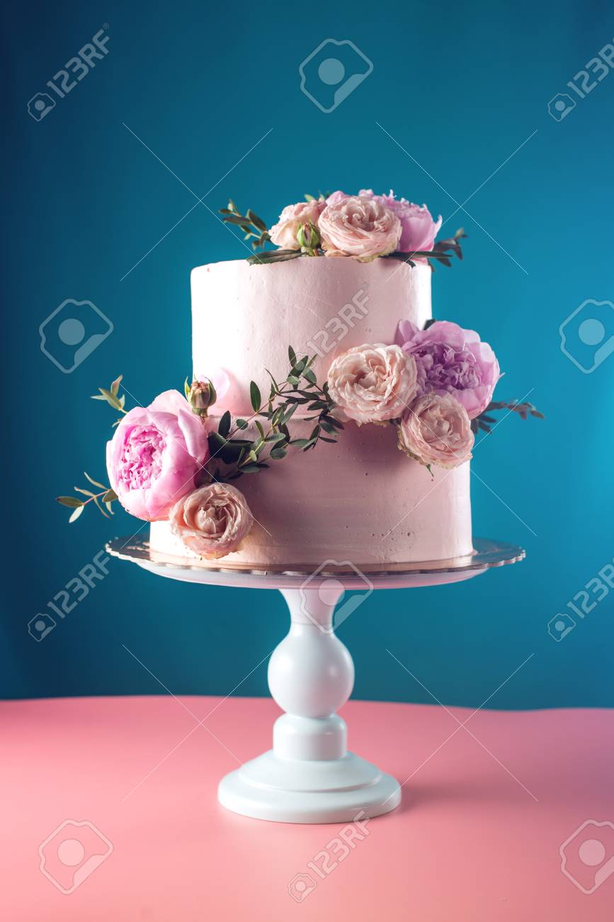 Bunk Pink Cream Wedding Cake Decorated With Fresh Roses On A.. Stock ...