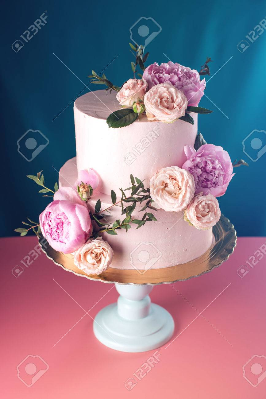 Bunk Pink Cream Wedding Cake Decorated With Fresh Roses On A Stock