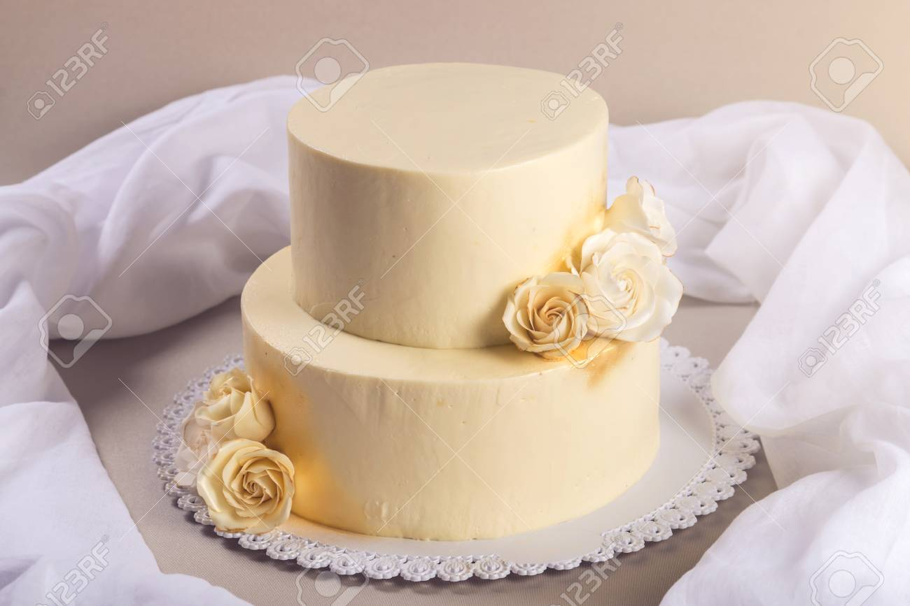 Beige 2 Tiered Wedding Cake Decorated With Mastic Roses Stands ...