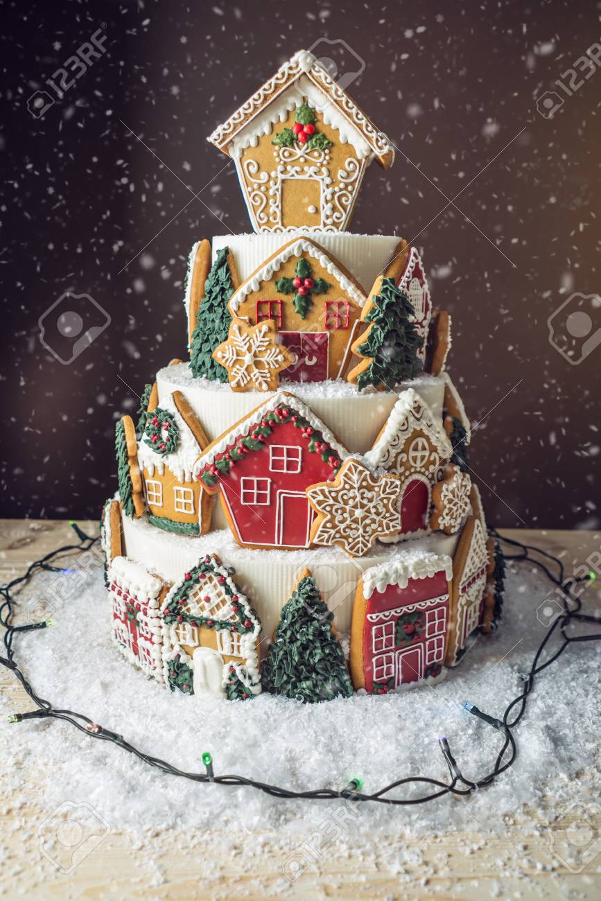 Large Tiered Christmas Cake Decorated With Gingerbread Cookies