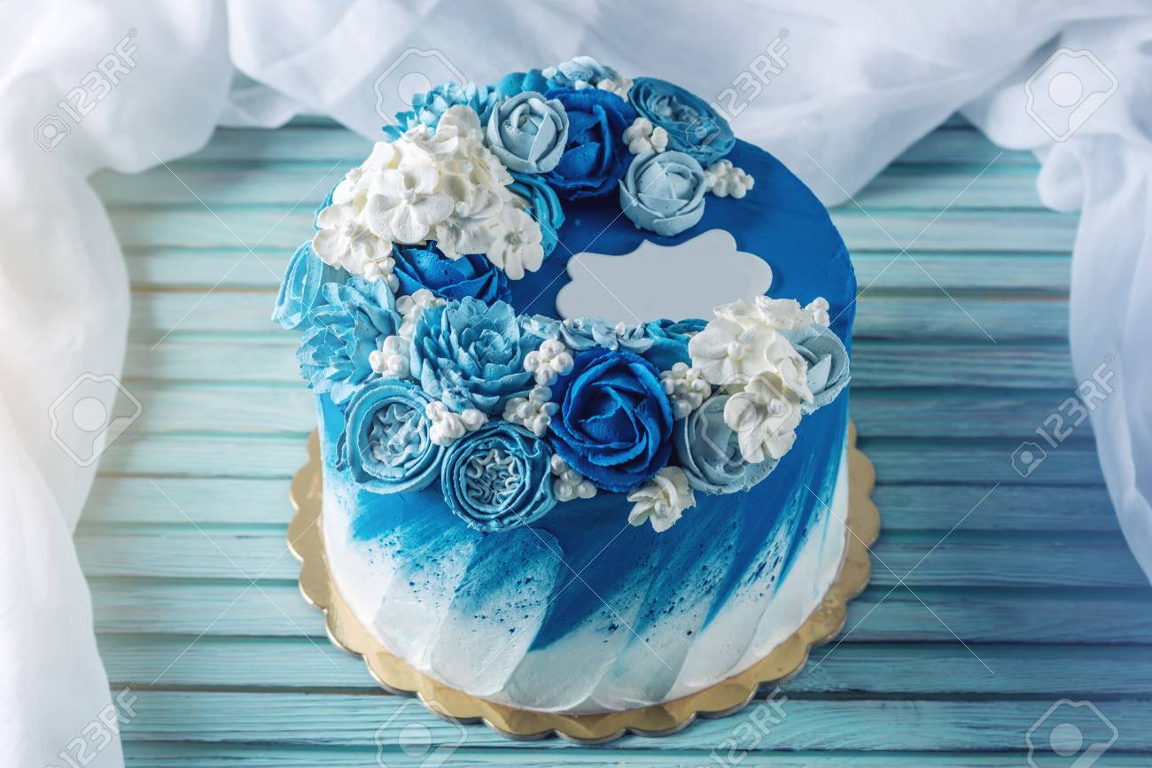Beautiful Blue Wedding Cake Decorated With White Flowers Of Cream A Place For Label