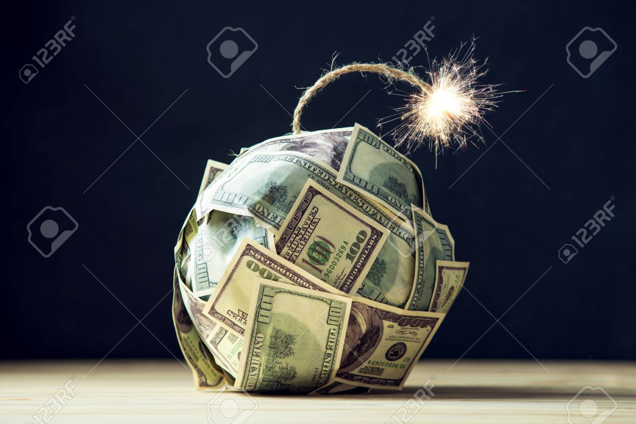 Big bomb of money hundred dollar bills with a burning wick. Little time before the explosion. The concept of financial crisis - 92554994