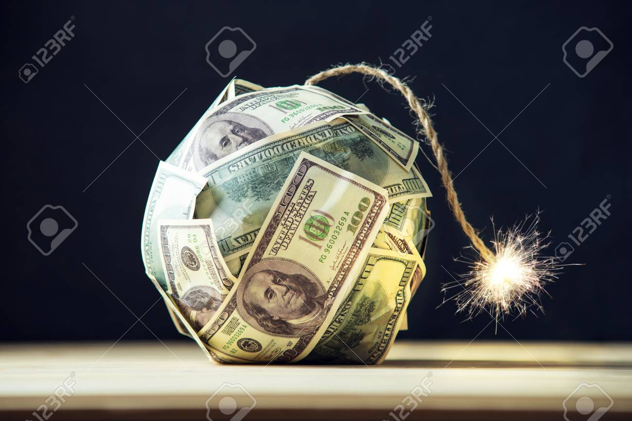 Big bomb of money hundred dollar bills with a burning wick. Little time before the explosion. The concept of financial crisis - 92426308