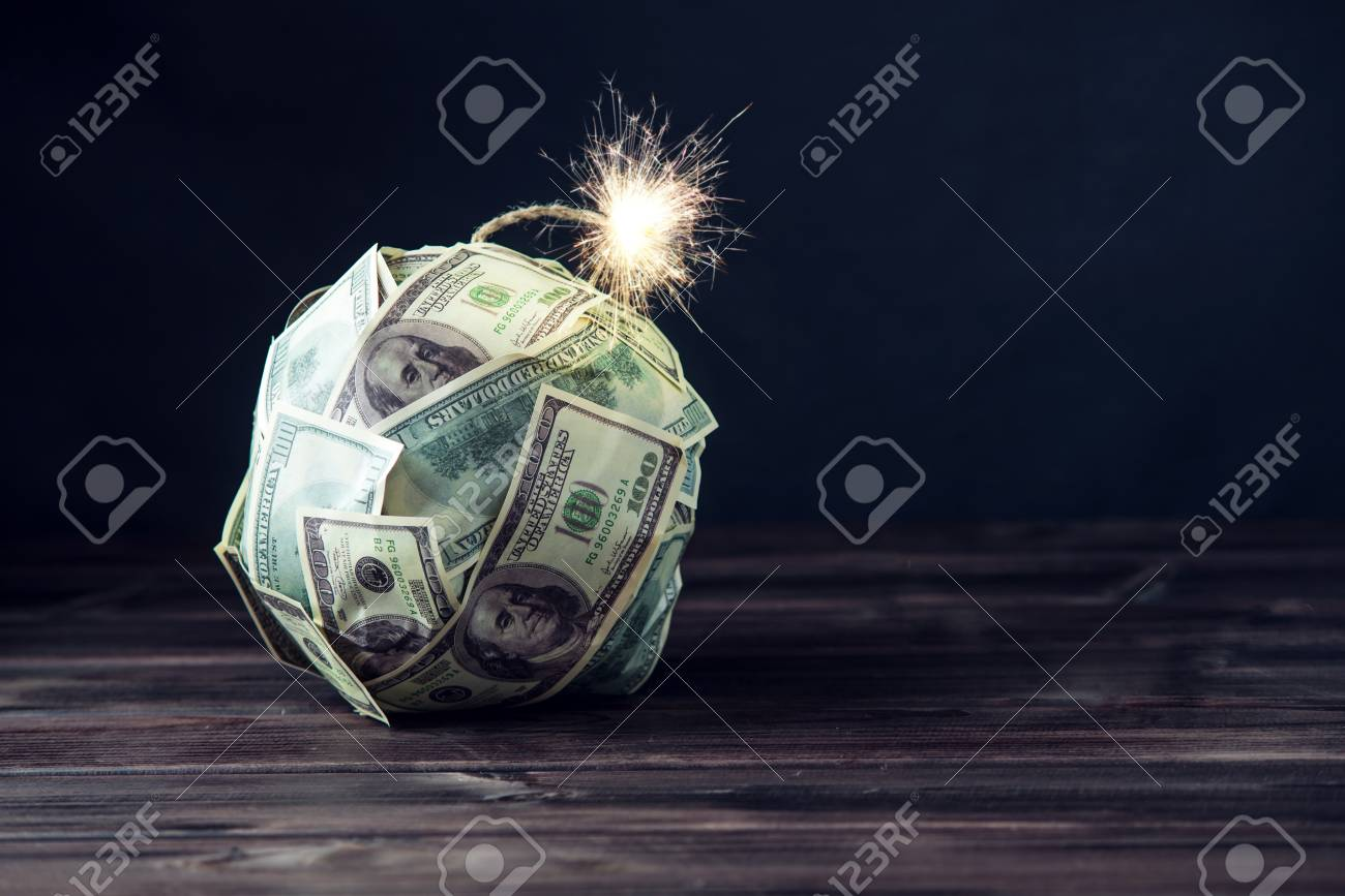 Big bomb of money hundred dollar bills with a burning wick. Little time before the explosion. The concept of financial crisis - 92625648