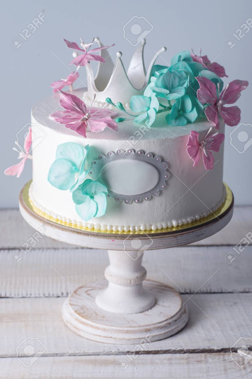 Beautiful white cake decorated with pink and turquoise flowers beautiful white cake decorated with pink and turquoise flowers and a princess crown the concept mightylinksfo