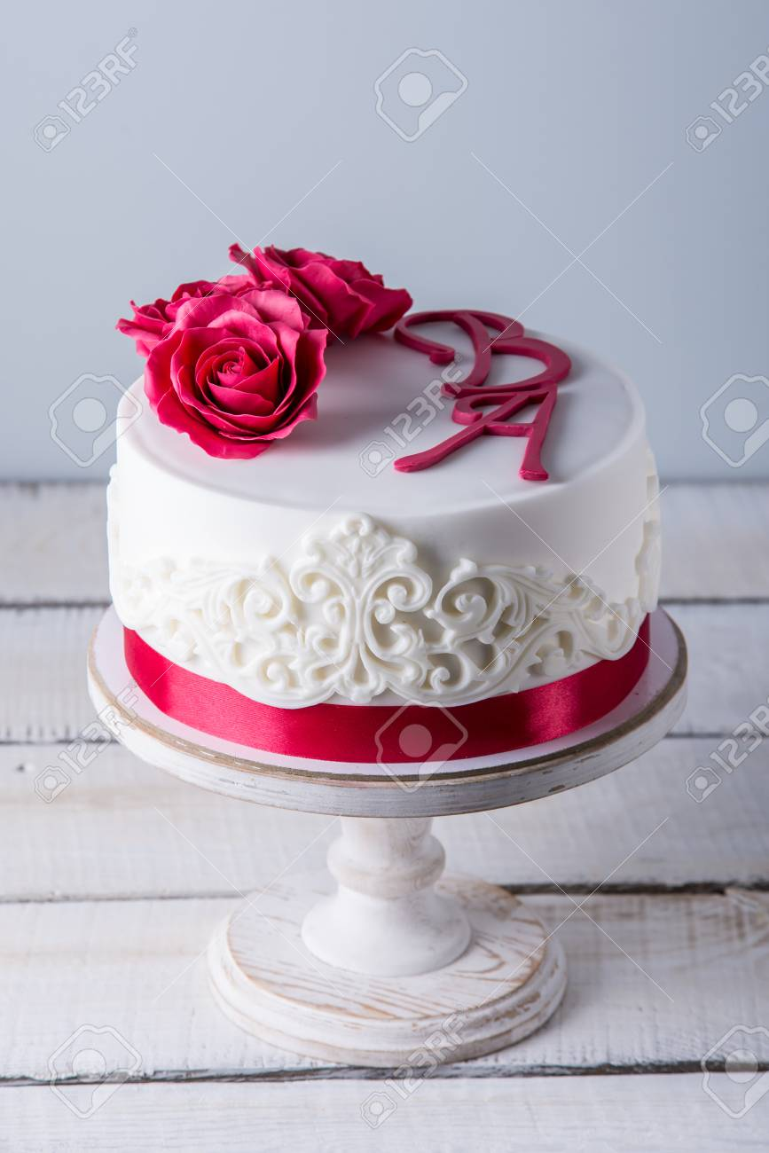 Beautiful White Wedding Cake Decorated With Flowers Red Roses