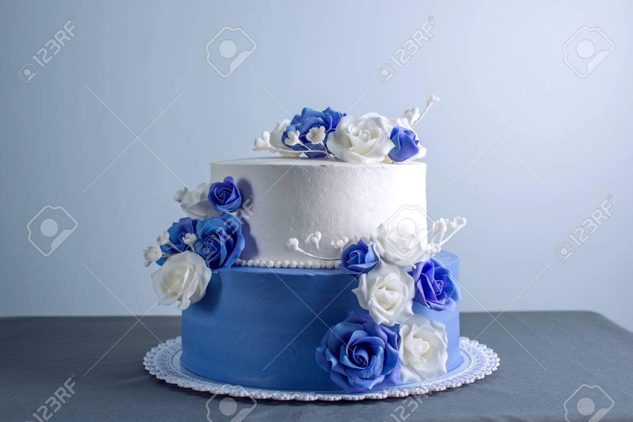 Beautiful Two Tiered White And Blue Wedding Cake Decorated With