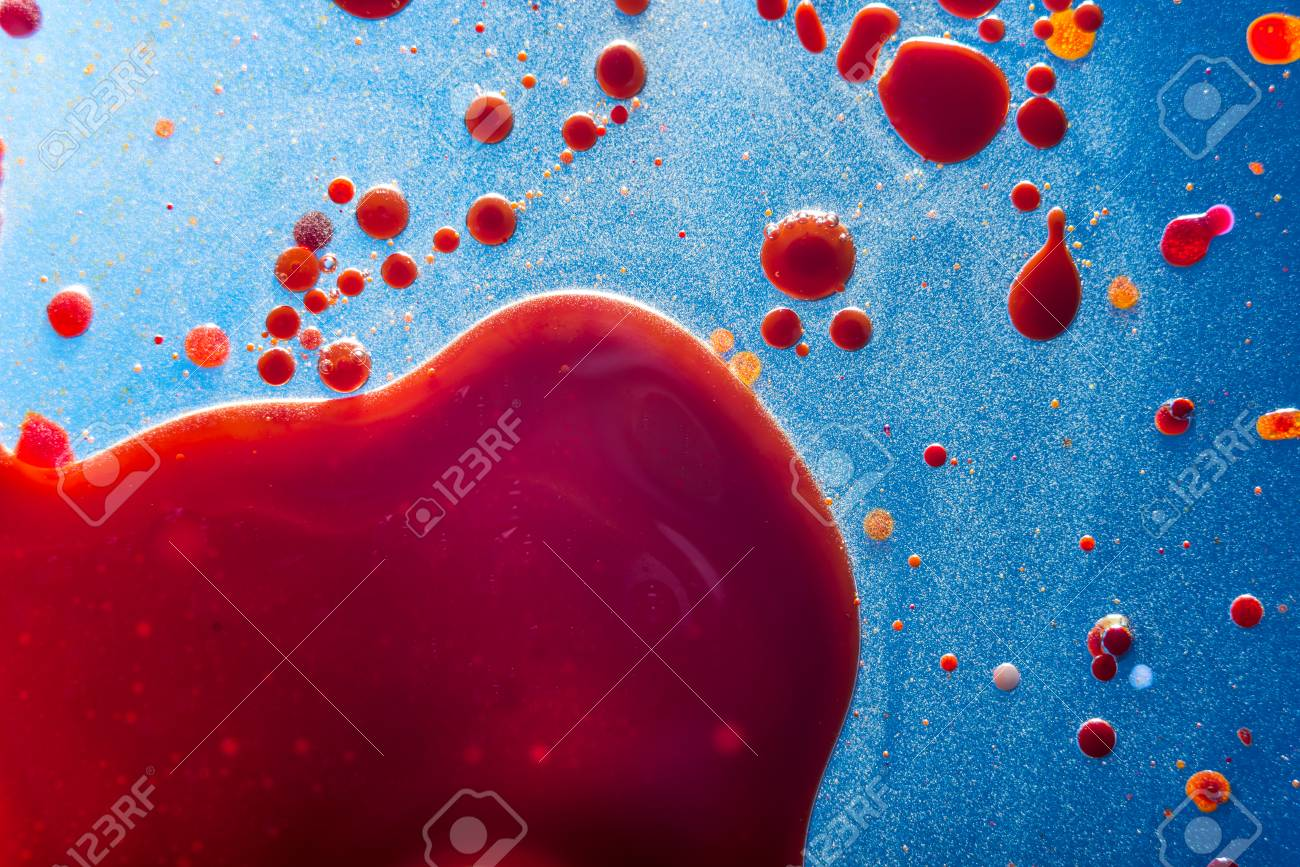 Red bubbles of blood cells on a blue background closeup  Abstraction
