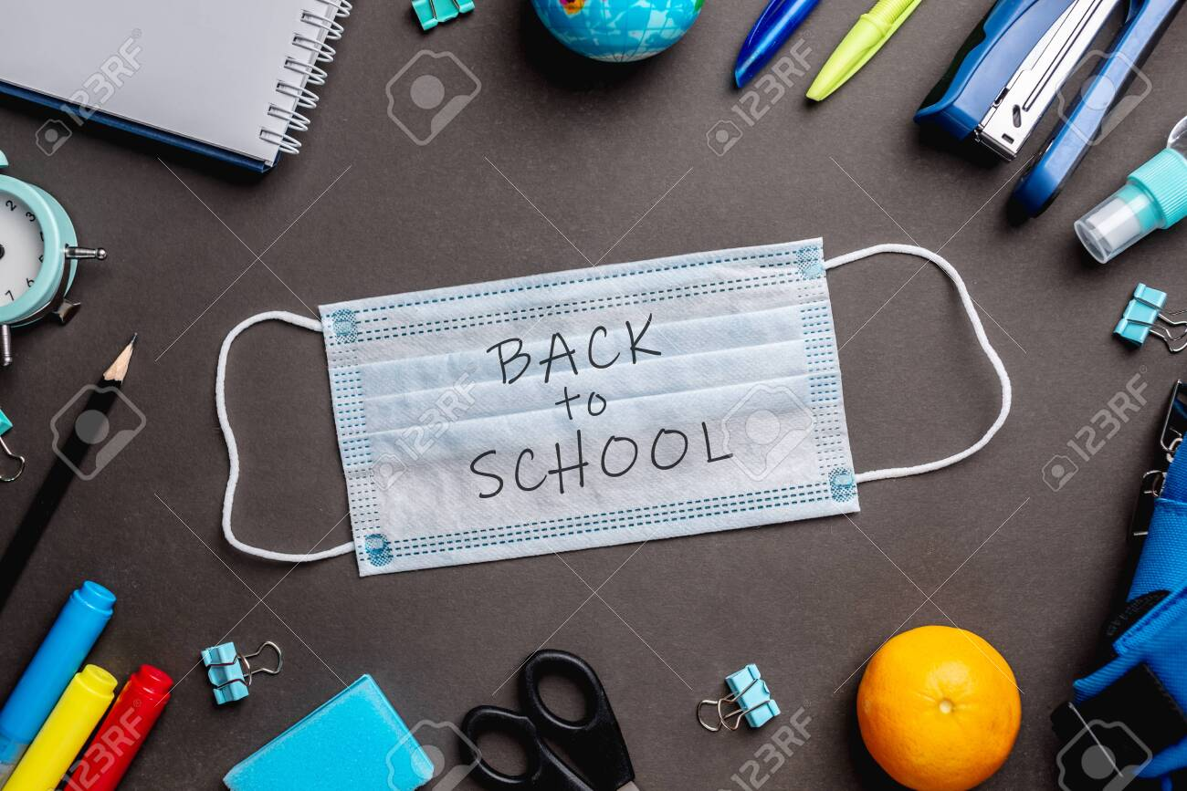 Stationery school supplies around the medical mask on black background. Top view. Concept of back to school. - 151265054