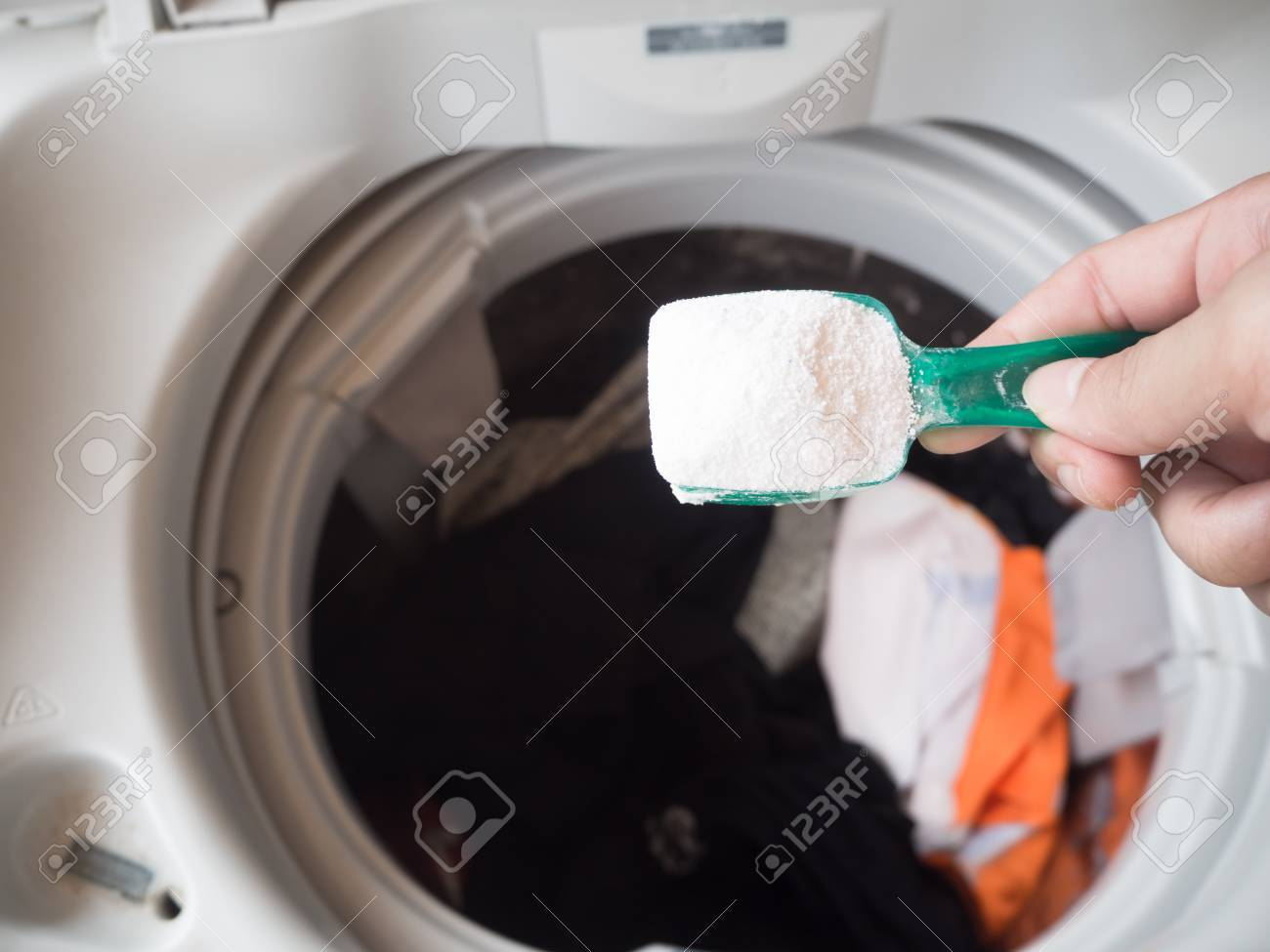 Pour Detergent Into Washing Machine Stock Photo