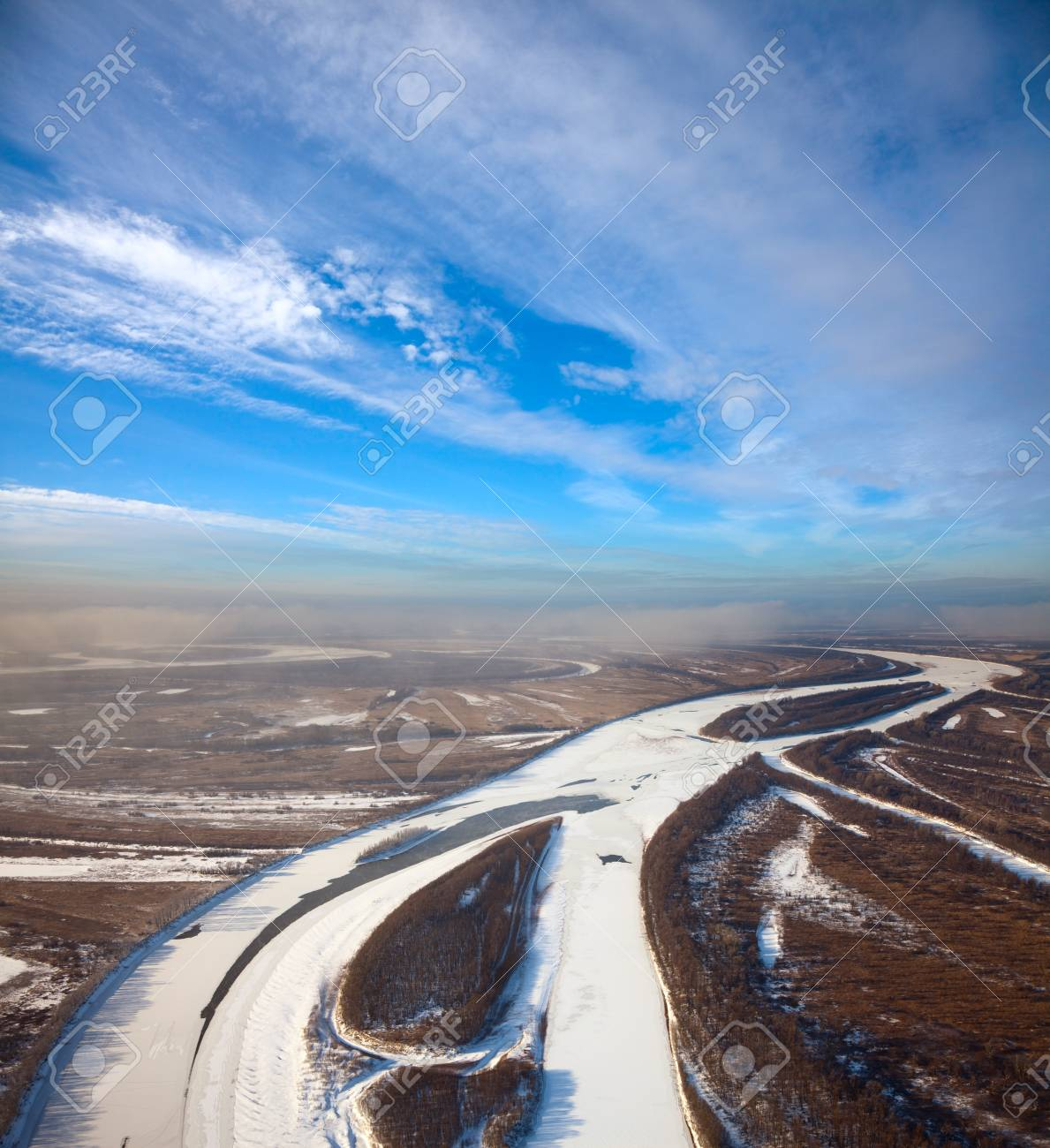 Aerial view of forest of plain and small river during a winter day. Stock Photo - 16293638