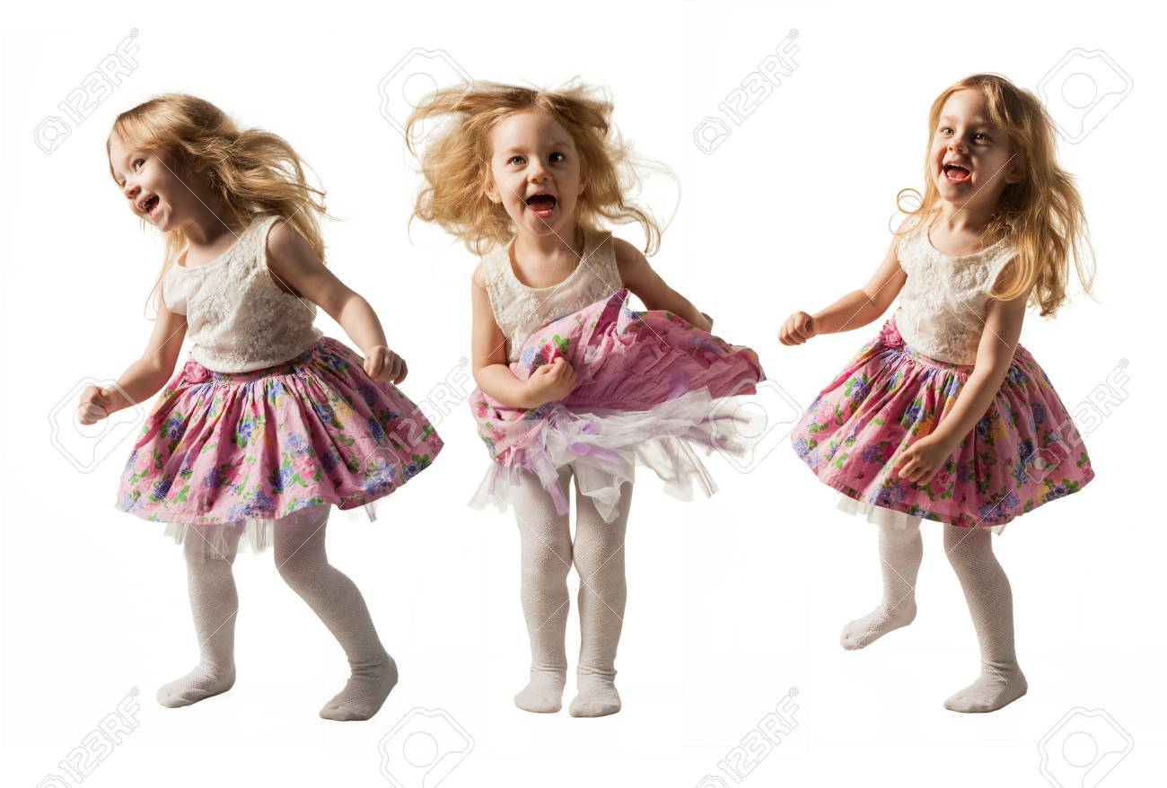 Cute little girl jumping with joy isolated on white background - 73597184