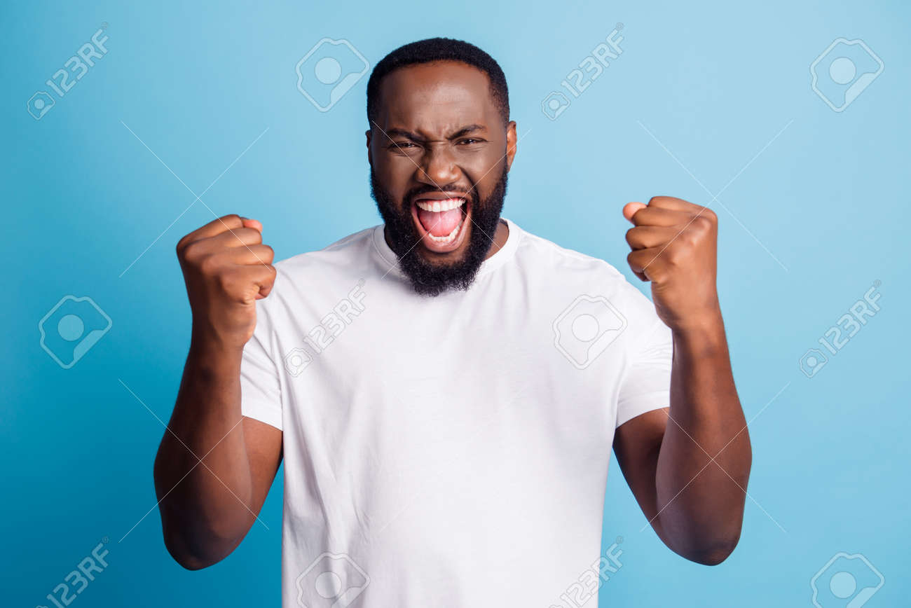 Cheering young man open mouth scream over blue background - 168587216