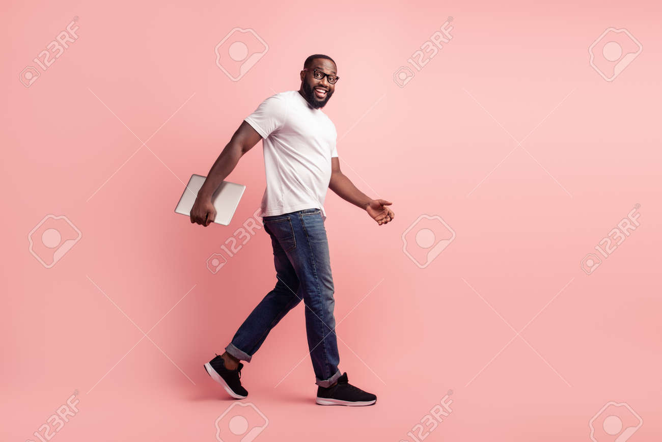 Young smiling african man walk carry laptop - 168904300